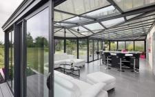 agrandissement de la maison avec une véranda en alumiium