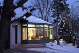 véranda en aluminium conçue par Vérancial, sous la neige